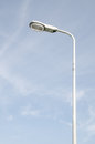 Street light with halogen lamp against blue sky Royalty Free Stock Photos