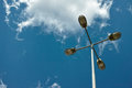 Street lighting pole lamp device against blue sky in daytime Stock Photography
