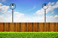 Street lighting and wooden fence with shrub Stock Image
