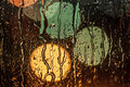 Street lights seen through rainy window Royalty Free Stock Photo