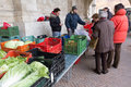 Street market in the medieval town of ascoli piceno marche region italy in the picture you can see a seller of vegetables and Royalty Free Stock Image