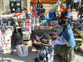 Street market scene with indigenous people uyuni bolivia august traditionally dressed woman and child while chossing a Royalty Free Stock Image