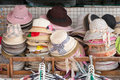 Street market selling hats and souvenirs in the touristic town photographed Stock Images