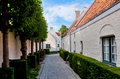 Street with medieval houses and trees in Bruges / Brugge, Belgium Royalty Free Stock Photo
