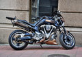 Street motorcycle parked in front of the building Stock Photography