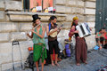 Street music group of young people making at popes palace in avignon in order to earn a little money or to sell cds with Stock Images