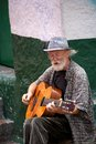 Street musician in bogota colombia may an unidentified old playing for money the streets of la candelaria the historic center of Royalty Free Stock Image
