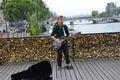Street musician busker entertain public on pont des arts in paris france september a france Stock Photos
