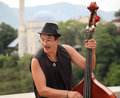 Street musician mostar bosnia and herzegovina august plays double bass the streets of mostar are the stage of the arts festival Royalty Free Stock Photo
