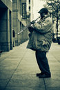 Street musician in new york playing instrument photo taken on th april Royalty Free Stock Image