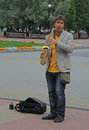 Street musician is playing saxophone outdoor in Chelyabinsk, Russia Royalty Free Stock Photo