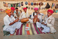 Street musicians play music on different traditional instruments Royalty Free Stock Photo