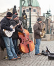 Street musicians in prague orchester with three on the charlesbridge guitar contrabass and sax Royalty Free Stock Image