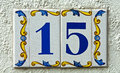 Street number plate with arabesque inlays Stock Image