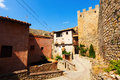 Street with old fortress wall in albarracin aragon spain Stock Photography