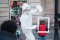 Street performer imitating statue of painter white with brush on the rambla barcelona spain Royalty Free Stock Image
