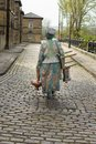 Street performer makes her way home over the cobbles