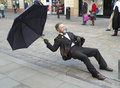 Street performer on the streets manchester england carrying out a trick balancing act Stock Photo