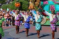 Street performers in a parade at disneyworld colorfullly dressed male disney s magic kingdom Stock Photo