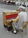 Street piano player in paris circa august unidentifed performing the city centre of august Stock Photos