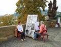 Street portrait artist painting Asian girl