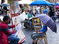 Street portrait florence italy april artist painting a caricature of a young boy Royalty Free Stock Image