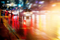 Street after the rain and traffic car at night, soft and blur Royalty Free Stock Photo