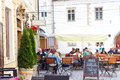 Street restaurant with umbrellas in cluj napoca romania may people resting under umbrella at quite central part of Royalty Free Stock Images