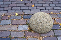 Street road brick background and granite ball Royalty Free Stock Photo