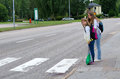 Street safety on the school way girls before zebra crossroad Royalty Free Stock Photos
