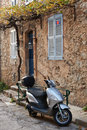 Street in saint tropez with moped typical provence france Royalty Free Stock Image