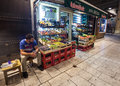 Street in sarajevo bosnia and herzegovina august salesman sits front of the grocery shop at night Royalty Free Stock Photography