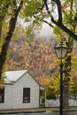 Street scene arrowtown colonial miner s cottage and streetlamp new zealand Royalty Free Stock Images