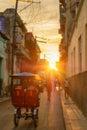 Street scene in Old Havana illuminated by the sun at sunset Royalty Free Stock Photo