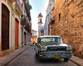 Street scene with an old rusty american car Royalty Free Stock Photo