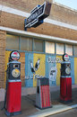 A Street Scene of Vintage Signs and Gas Pumps, Lowell, Arizona Royalty Free Stock Photo