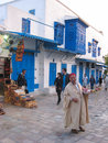 A street seller wearing a traditional galabia and fes sidi bou said tunisia Stock Photo