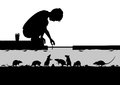 Street sewer editable vector silhouettes of a young boy feeding rats in a with all figures as separate objects Royalty Free Stock Photography