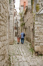 A street of sibenik croatia may couple middle aged tourists in typical dalmatian town croatia on may in Royalty Free Stock Image