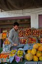 Street side fruit vendor islamabad pakistan september a pathan stands among his selection of fruits in a suburb of s Royalty Free Stock Photo