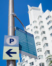 Street sign in miami beach next to an art deco hotel giving directions landmarks with on the background Royalty Free Stock Images