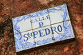 Street sign on a stone wall in Colonia del Sacramento, Uruguay Royalty Free Stock Photo
