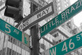 Street signs for fifth avenue and west nd street in nyc little brazil manhattan new york city color splash efect picture Royalty Free Stock Photos
