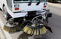 A street sweeper with brushes Royalty Free Stock Image