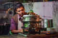 Street vendor picture of fast food selling working on his stove in unhygienic environment Royalty Free Stock Photography