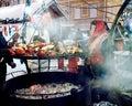Street vendor prepares food