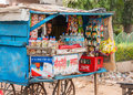 Street vendor sells basic grocery products agra india circa february in a typical small booth on wheels Royalty Free Stock Images
