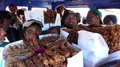 Street vendors inside a bus madagascar antananarivo sell food laden traveling in Stock Photography