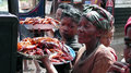 Street vendors madagascar antsirabe women selling seafood on the to the passengers of a bus Royalty Free Stock Photos