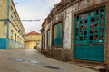 Street view of an old house with turquoise door. Royalty Free Stock Photo